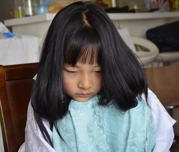 Close-Up Of Girl Sulking At Home