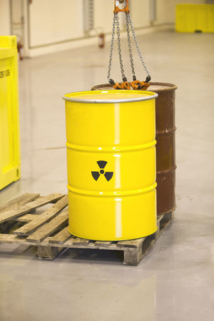 Nuclear waste disposal. Lifting Nuclear Power Radioactive Signs Barrel Container Dangerous Environment Hazard Indoors  No People Nuclear Energy Nuclear Waste Nuclear Waste Symbol Radiation Radioactive Material Radioactive Waste Safety Securing Storage Toxic Toxic Substance Warehouse Waste Disposal Waste Management Yellow