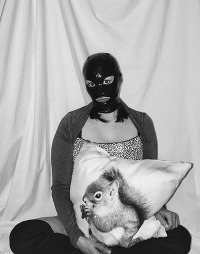 Portrait of man sitting with dog