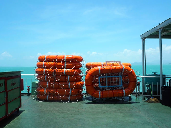 Inflatable lifeboats on ship against sky