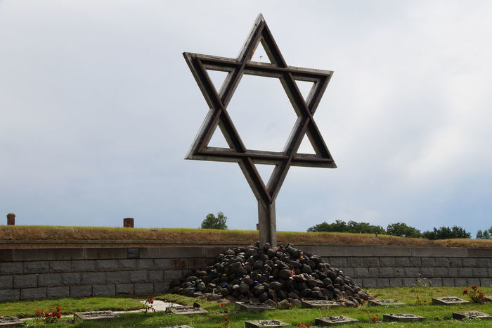"""It is more than important to """"feel"""" the history, even when it brings you to a sad place like this. Building Exterior Concentration Camp Day Growth Historical Building Historical Monuments House Jewish Memorial Jewish Star Nature No People Outdoors Plant Prague Sky Terezín Theresienstadt Tree"""