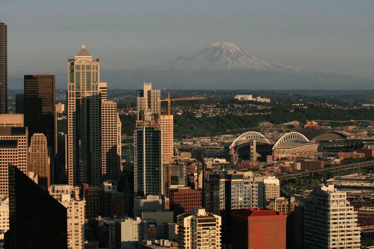 Seattle urban city skyline with rainer mountain at sunset, washington, usa. top view cityscape.