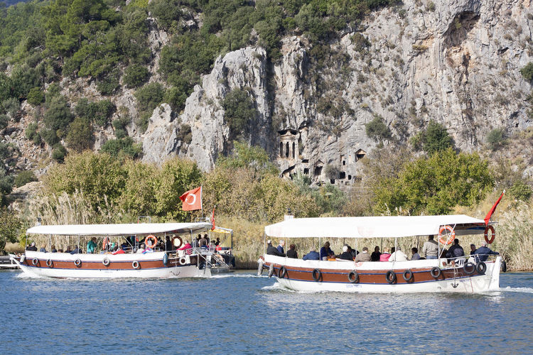 Beauty In Nature Boat Dalyan çayı River Day Lycian Tomb Mode Of Transport Mountain Nature Nautical Vessel Outdoors Sailing Scenics Siteseeing Siteseeing Boat Tourism Tranquility Travel Destinations Tree Turkey Water Waterfront