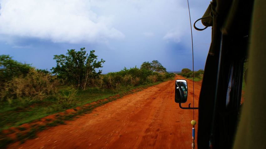 Africa Kenya Tsavo Est Nature On Moves Road Sky Cloud - Sky Tree Mode Of Transportation Environment Connection Land Vehicle Day Land