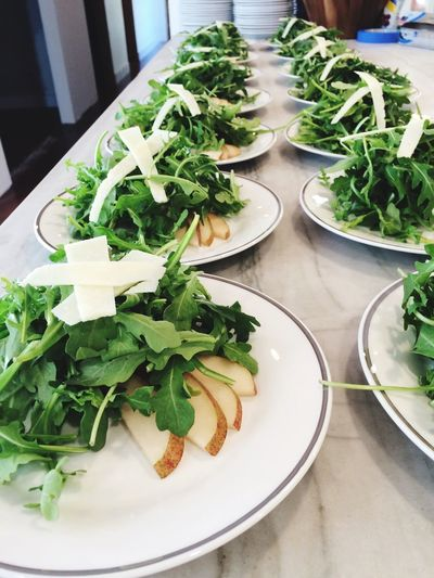 Close-up of salad served in plates arranged on table