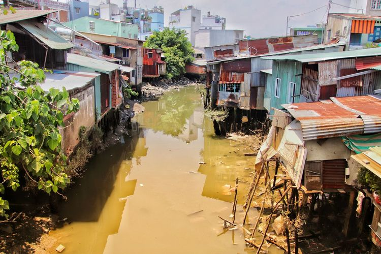 Slums. Asia. Slum Slums Dirt Dirty Dirty Water  Slum Area Riverside Ghettoscenes Pollution Pollution Of The Environment Illness Malaria Dengue  Zika Virus Mosquito City Flood Water Ghetto Building Exterior Architecture Hurricane - Storm Tornado Residential Structure Meteorology Residential District