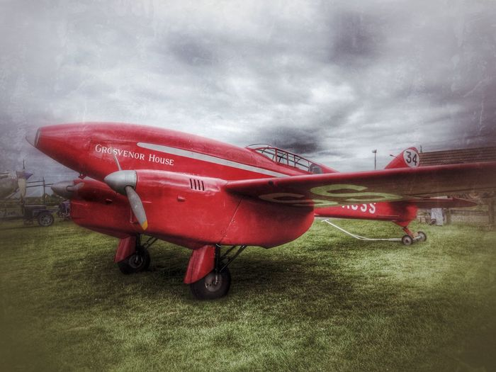 De Havilland DH88 Comet Racer, 'Grosvenor House', at Old Warden airfield, Bedfordshire, England. Aeroplane Aircraft Airfield Airplane Aviation British Classic Comet Racer De Havilland DH88 England English Grosvenor House Old Warden Plane Red Shuttleworth Collection Uk Vintage