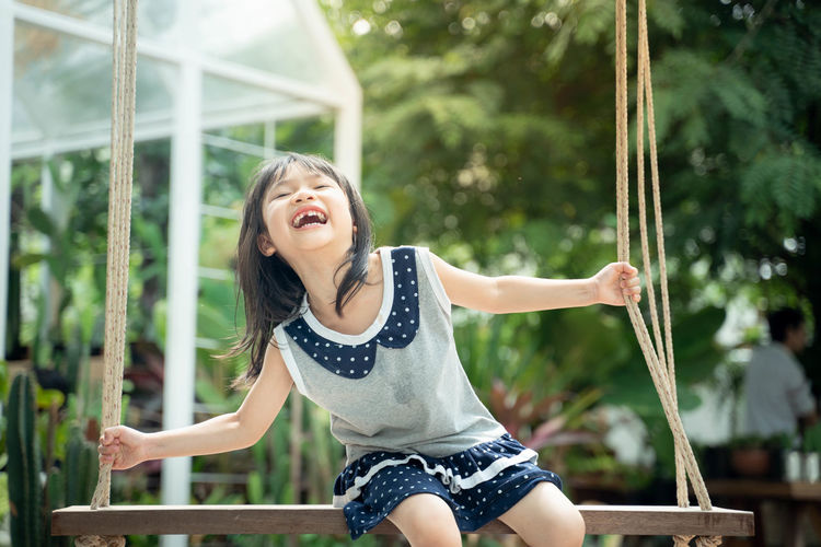 Real People One Person Child Happiness Leisure Activity Casual Clothing Childhood Emotion Lifestyles Focus On Foreground Fun Girls Day Playing Front View Enjoyment Women Playground Outdoors Mouth Open Innocence Excitement Human Arm