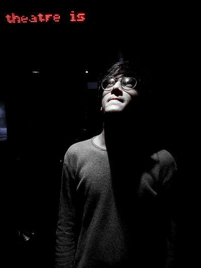 Young man looking up at night