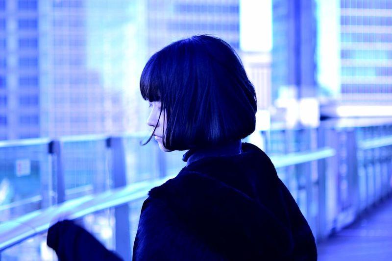 Rear view of woman looking at camera