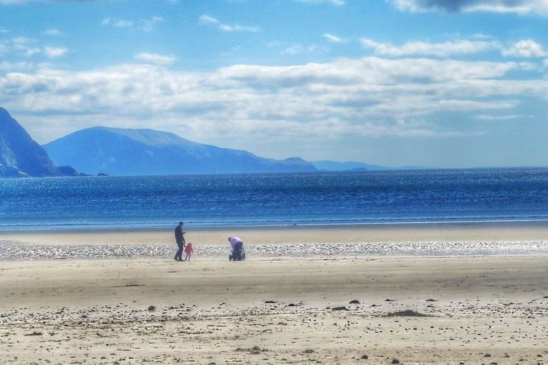 A young family on Keel Beach - Achill Island, Ireland - 23 April 2016 Beach Photography Beach Life Beach Family Time Familyday Beach Family Keel Wildatlanticway Coastline Enjoying The Sun County Mayo Enjoying Life Mayo Ireland Achill Island Mayo Achill Atlantic Ocean WestCoast Cloudporn Irish Coast April 2016 April2016 Ireland Sand The Great Outdoors With Adobe