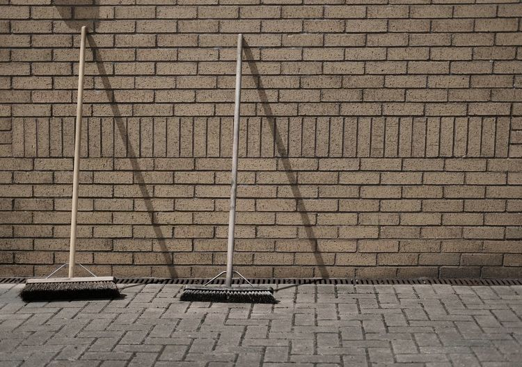 sweeping brushes Brick Wall Brooms  Architecture Brick Building Broom Building Exterior Built Structure Day No People Outdoors Sweeping Brush