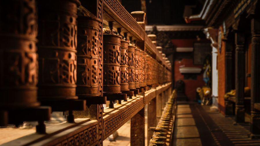Row of wooden objects in temple