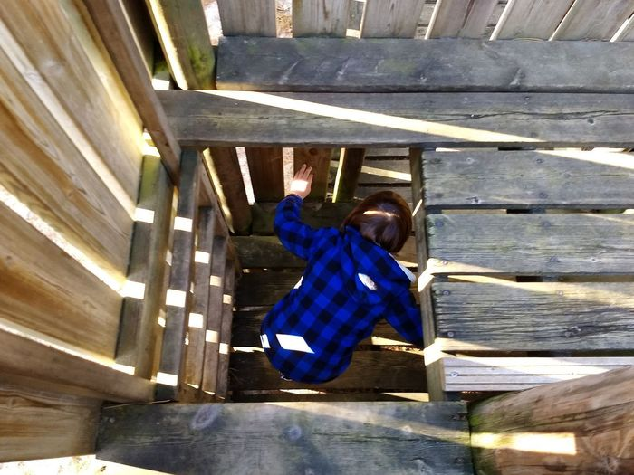 High angle view of man climbing staircase