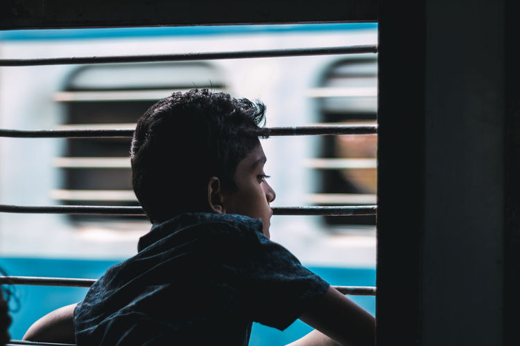 joy of sitting in a window seat .. Travel Transportation Train Railway Window Seat Contemplating darkness and light Shadow Shadows & Lights Chennai Iron Blue Selective Focus Indoors  This Is Family Headshot Looking Through Window Window Window Frame The Traveler - 2018 EyeEm Awards