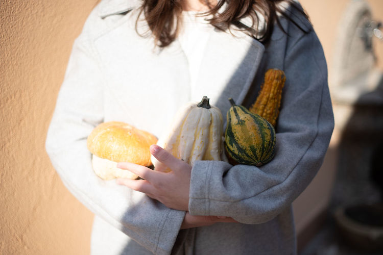 Autumn Mood Food And Drink Food Holding One Person Midsection Freshness Healthy Eating Wellbeing Casual Clothing Focus On Foreground Adult Vegetable Day Close-up Indoors  Standing Front View Human Hand Women