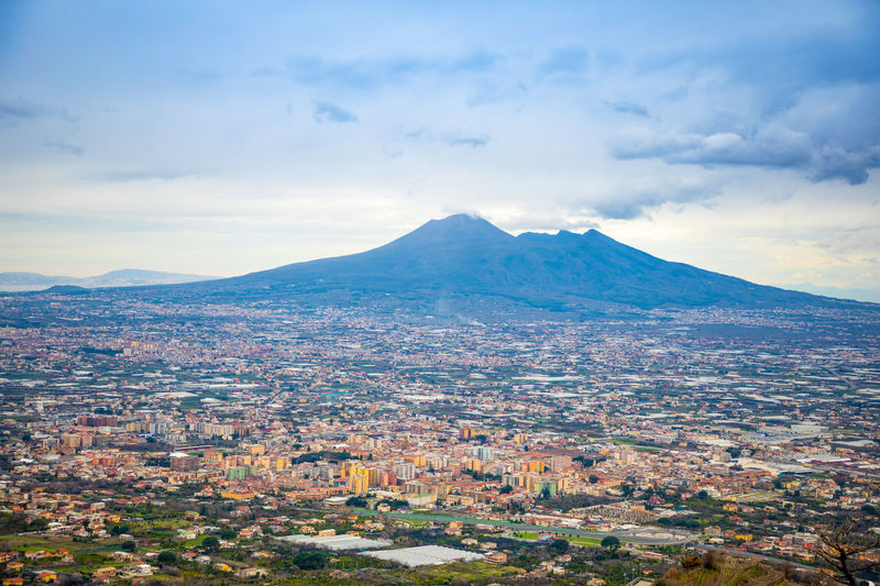 Pompeii  Italy Vesuvio Volcano Panorama Landscape City Mountain Nature Cloud - Sky Sky Scenics - Nature Environment Beauty In Nature Tranquil Scene No People Day Tranquility Mountain Range Architecture Building Exterior Land Outdoors Travel Destinations Mountain Peak Cityscape Snowcapped Mountain