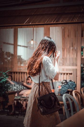 Behind a beauty girl Cafe Women Standing Wearing Visiting Spending Money