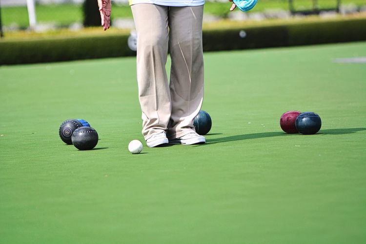 Lawn bowl on the green field Business Green Field EyeEm Selects EyeEm Best Shots EyeEmBestPics Eyeemphotography Sport Lawn Lawn Bowls Bowl Bowling Healthy Golfer Golf Course Sportsman Golf Club Green - Golf Course Low Section Golf Competition Athlete Competitive Sport Sports Activity Grassland Human Foot