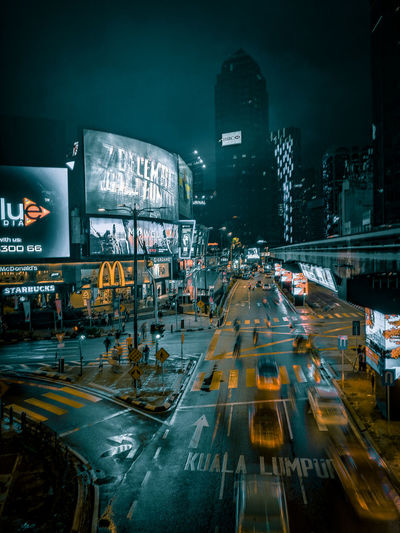 kuala lumpur after rain Junction Kuala Lumpur Urban Desaturate City Life City Illuminated Cityscape Architecture Traffic Arrow Sign Traffic Road Signal Vehicle Office Building Stoplight Rainy Season