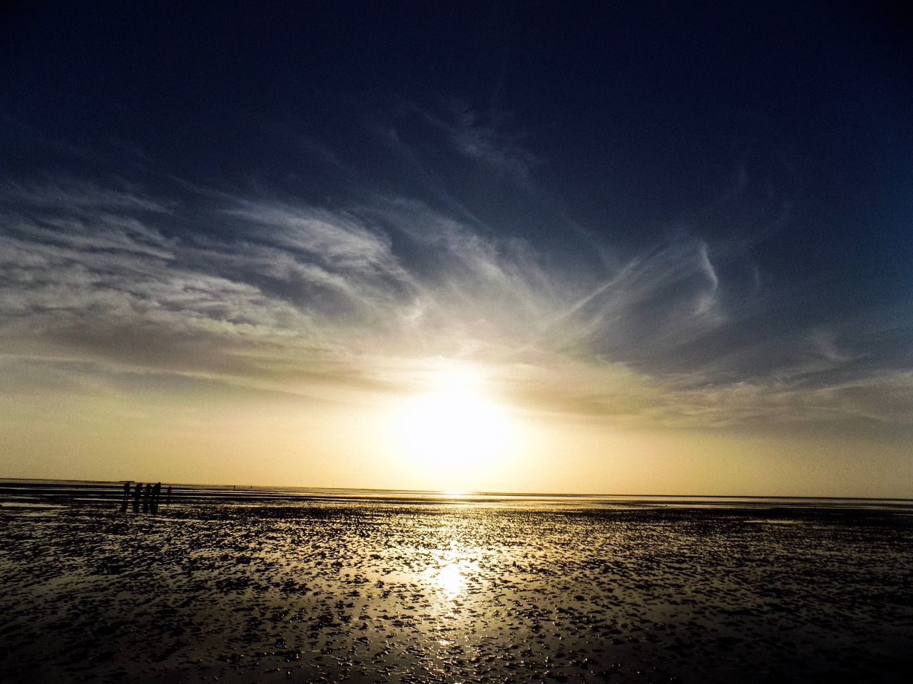 sunset, scenics, sea, sky, beauty in nature, sun, tranquility, tranquil scene, nature, horizon over water, water, cloud - sky, outdoors, beach, silhouette, sunlight, reflection, no people, sand, day