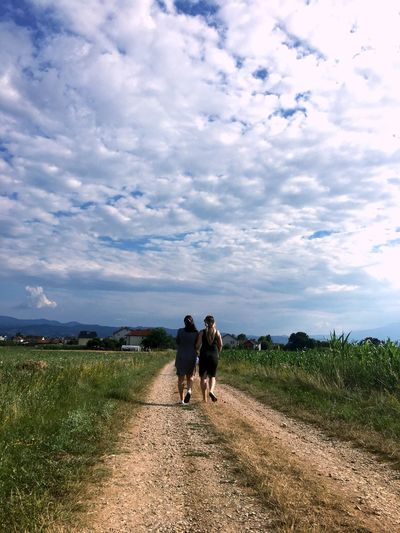 Walking Sky Cloud - Sky Rear View Togetherness Grass Nature Full Length The Way Forward Field Two People Women Day Landscape Real People Road Dog Beauty In Nature Men Outdoors Lost In The Landscape Press For Progress This Is Family