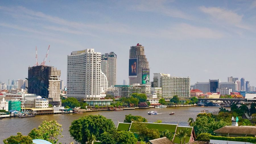 Bangkok by river Architecture City Building Exterior Built Structure Sky Building Office Building Exterior Nature Landscape Modern Cityscape Residential District Urban Skyline Water Skyscraper Cloud - Sky Travel Destinations Office Tall - High No People