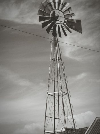 Windmill Black And White Black&white Monochrome Black & White Fine Art Photography Power Line  Cable Check This Out Eyeem4photography Low Angle View Built Structure Architecture Directly Below Geometric Shape Sky High Section Wind Power Alternative Energy Renewable Energy Overcast EyeEm Gallery Monochrome Photography Mettalic Detail