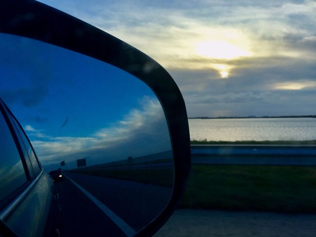 Sky Cloud - Sky Sea Sunset Transportation Water Nature Car Land Vehicle Scenics Outdoors Side-view Mirror Horizon Over Water Day Beauty In Nature Morning Sky IPhoneography Netherlands Light And Shadow Tranquil Scene