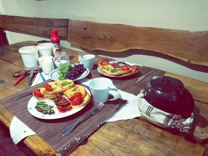 Guest's breakfast for the day Ready-to-eat Black Olive Full Length Freshness Greek Food Healthy Eating Table Breakfast Bread Plate Food And Drink Food Serving Size Directly Above Close-up High Angle View Armchair Sitting Living Room Nature Lifestyles Day Tree Meal Chair