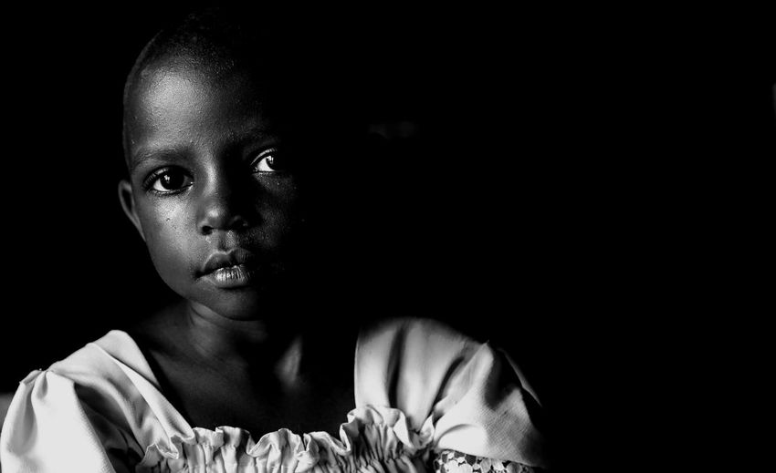 Enfnat noir Portrait Headshot One Person Child Front View Black Background Looking At Camera Lifestyles Indoors  Copy Space Close-up Studio Shot Childhood Boys Real People Males  Girls Dark Human Face Innocence Teenager Contemplation African African Child International Women's Day 2019 My Best Photo