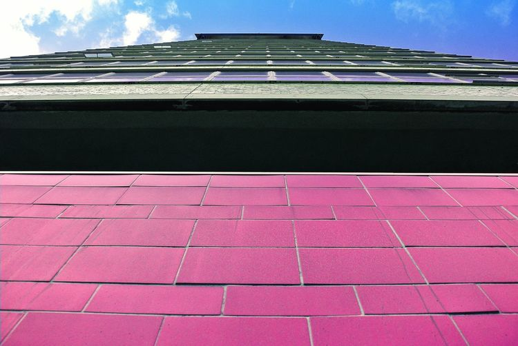 Wall - Building Feature Copy Space Architecture Built Structure Building Exterior Sky Cloud - Sky Geometric Shape Vibrant Color No People Modern Abstract Art Windows Artistic Full Frame Building Architectural Feature Close-up Colors City Atmosphere Architecture_collection Day Outdoors Pink Color Low Angle View Travel City History My Best Photo