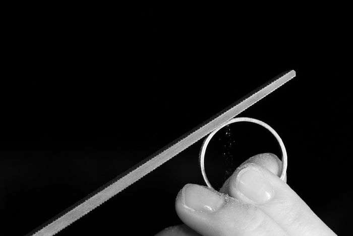 Black Background Blackandwhite Craft Equipment Extreme Close Up File Finger Goldsmith Hand Holding Man Made Object Part Of Person Personal Perspective Rasp Ring Studio Shot Working