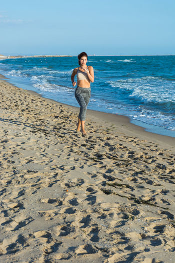Running Run Running Water Jogging Jog Jogger Woman Woman Portrait Woman Power Sea Beach Land Full Length Sand Water One Person Horizon Horizon Over Water Leisure Activity Sky Holiday Nature Motion Trip Vacations