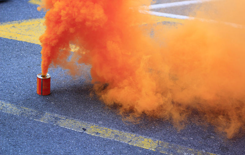 Orange smoke that exits from a cans
