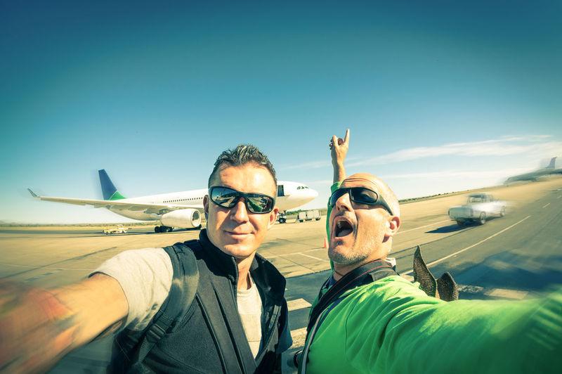 Men At Runway Against Sky
