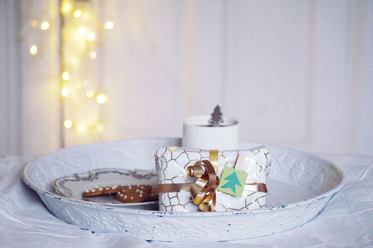Close-Up Of Gift And Christmas Decoration On Table
