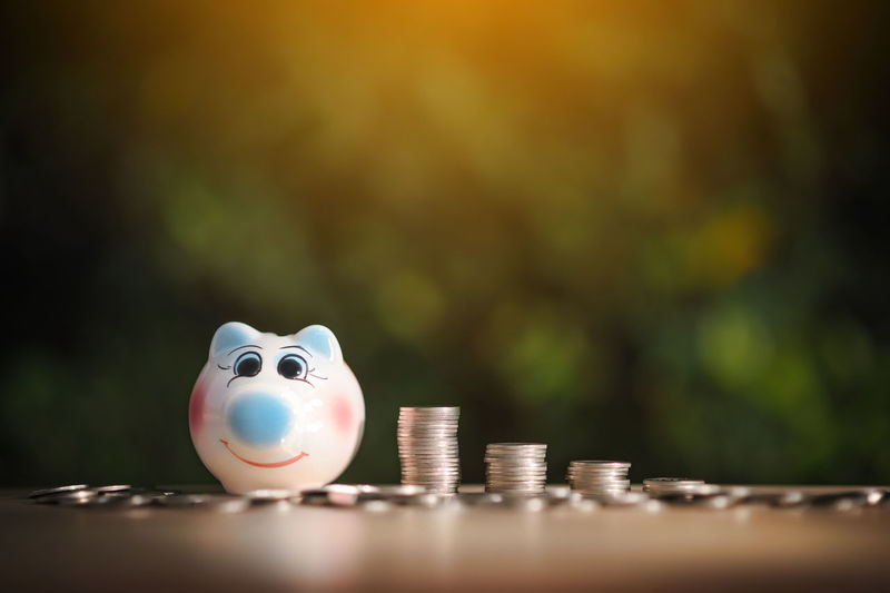 Saving to buy a house or home savings concept with money coin stack growing.Saving money concept. Close-up Coin Currency Day Finance Indoors  No People Piggy Bank Savings Selective Focus Wealth