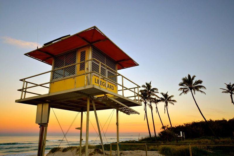Low angle view of lifeguard hut at sunset