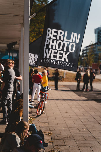 Berlin Photo Week 2018 Berlin Photo Week BPW18 EyeEem City Group Of People Street Real People Text Architecture Women Building Exterior Communication Men Adult Large Group Of People Crowd Built Structure Day Lifestyles Western Script Sign City Life Outdoors Message