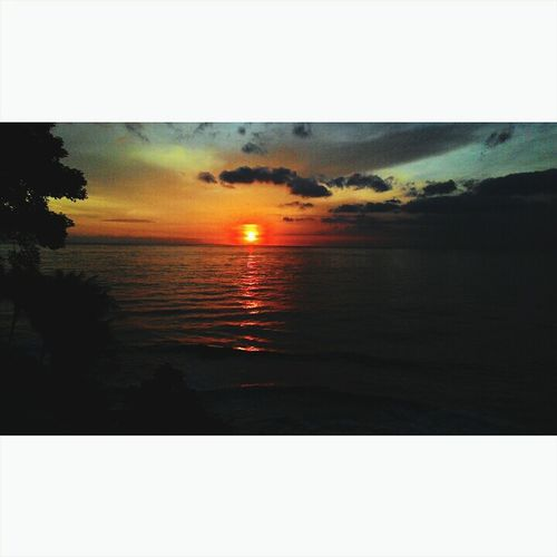 Sunset Beautiful Sunset Clouds And Sky Beach Senggigistreet  Senggigibeach Lombok-Indonesia
