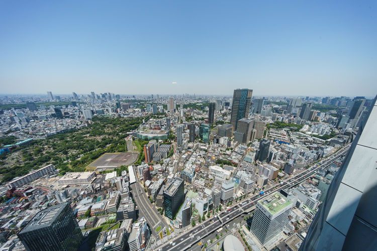 High angle view of modern buildings in city against clear sky