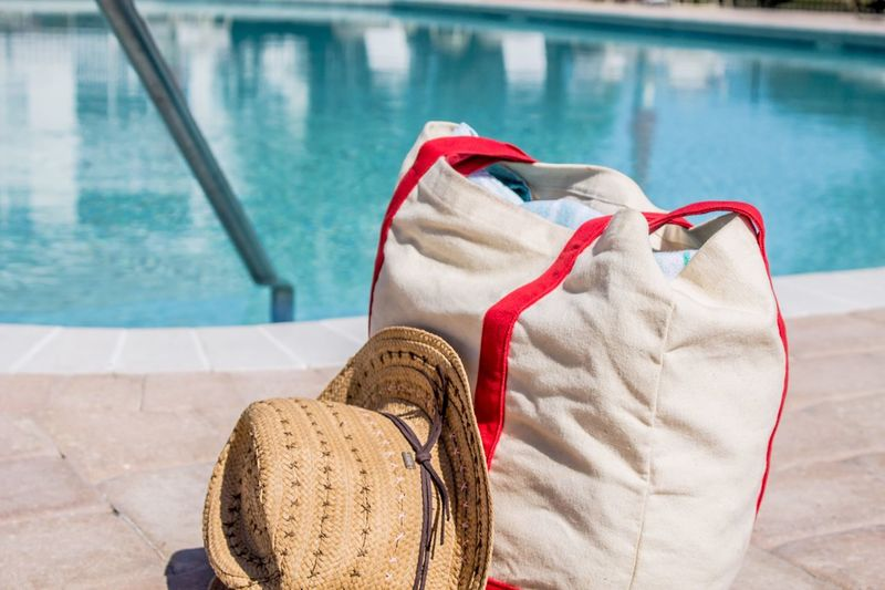 EyeEm Selects Water Focus On Foreground Day Swimming Pool Outdoors One Person Nature Low Section Close-up People Bag Pool Bag