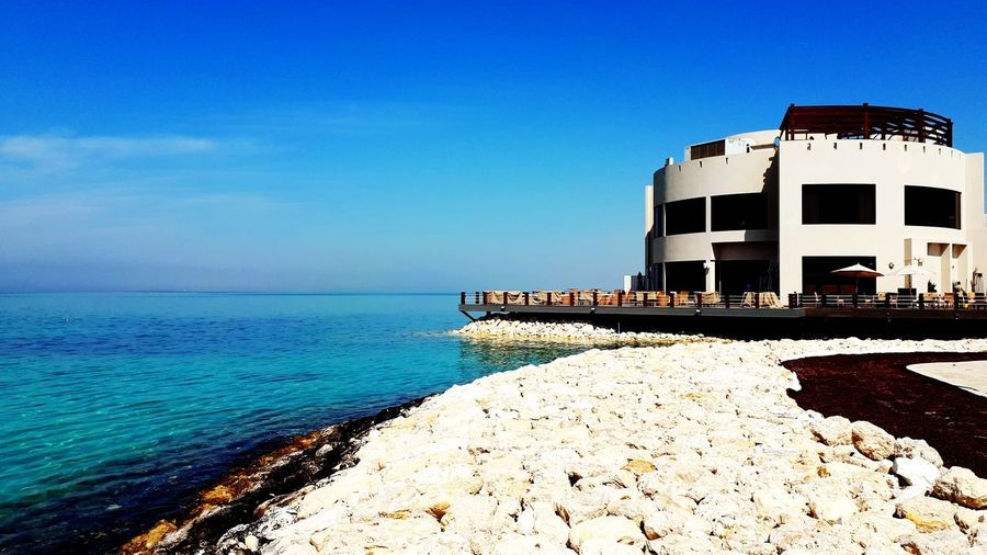 Middle East Ocean Bahrain Sea Beach Built Structure Water Building Exterior Outdoors Sky Architecture No People Blue Clear Sky Day