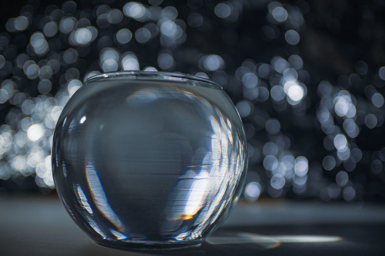Close-up of glass container against defocused lights