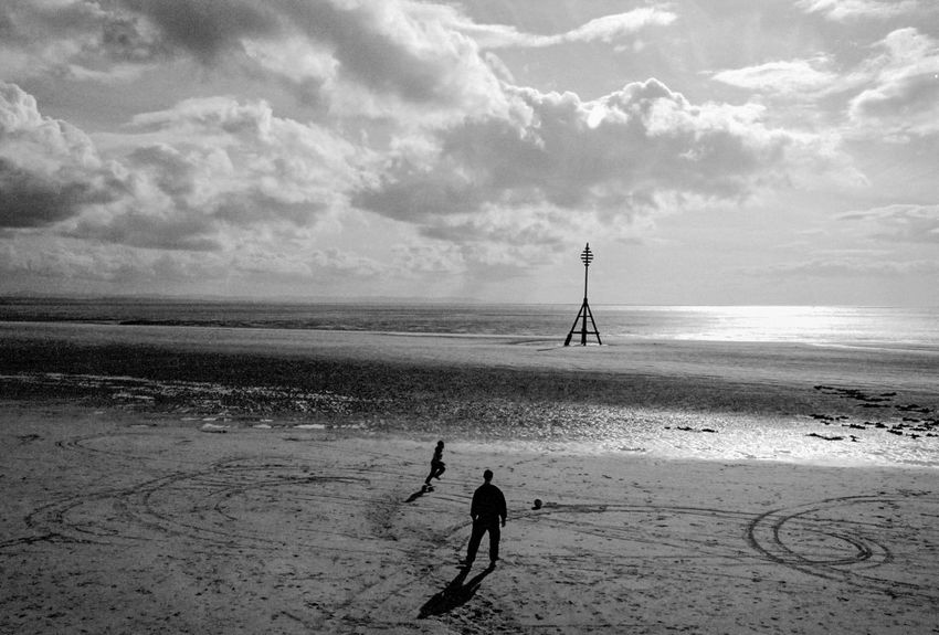 Dad and lad playing football on the beach Beach Black & White Black And White Blackandwhite Coastline Crosby Crosby Beach Father & Son Football Grainy Liverpool Merseyside Monochrome Ocean Scenics Sea Shore Soccer Sport Sport In The City Sports Photography Water Two Is Better Than One Fatherhood Moments