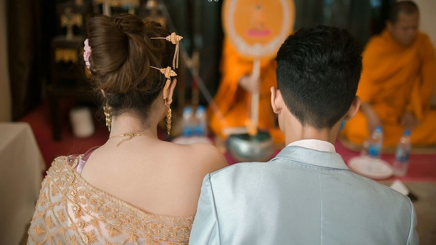 Rear view of couple at wedding