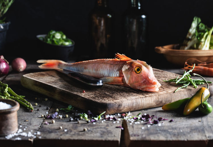 Close-up of fish on cutting board