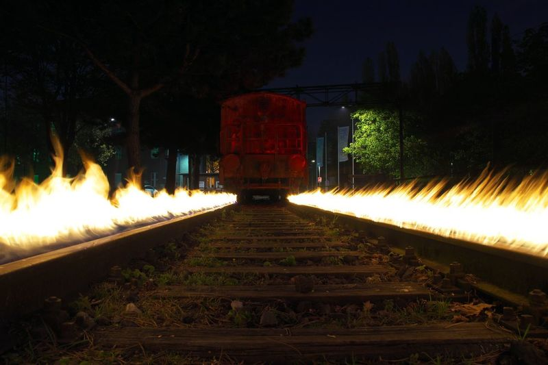 Nightphotography Long Exposure LongTerm Illuminated Longexposure Lapp Lightpainting Lightpaintingphotography Lightgraffiti Lightpaint Lights In The Dark Lightpaintingart Outdoors Train Train Rail Rails Trainphotography Fire Burning Rails Red Light Photography Light Painting Bulbphotography Bulb Bulbexposure