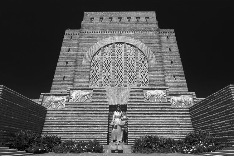 Low view, wide angle shot of the Voortrekker monument in South Africa Arch Architecture Belief Building Building Exterior Built Structure Façade History Low Angle View Nature Night Place Of Worship Religion Sky Spirituality The Past Two People
